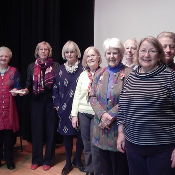 Marian Beard hands over a £600 donation raised by the Walberswick WI towards the Fish Project in Tamil Nadu